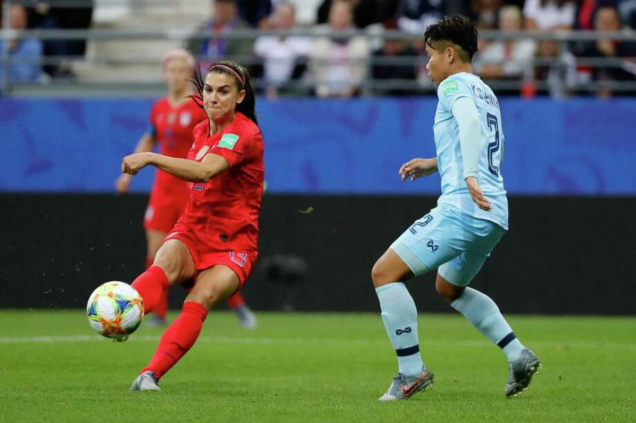 United States' forward Alex Morgan (L) vies for the ball with Thailand's defender Kanjanaporn Saenkhun during the France 2019 Women's World Cup Group F football match between USA and Thailand, on June 11, 2019, at the Auguste-Delaune Stadium in Reims, eastern France. (Photo by Thomas SAMSON / AFP)THOMAS SAMSON/AFP/Getty Images Photo: THOMAS SAMSON / AFP or licensors