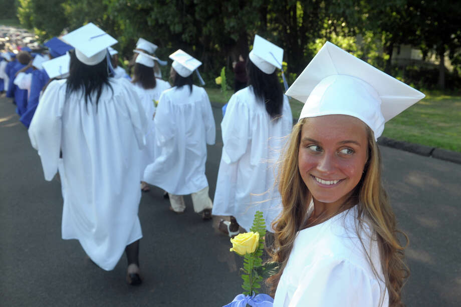 Gianna Graziano walks with her classmates as they enter graduation for the Bunnell High School Class of 2019, in Stratford, Conn. June 11, 2019. Photo: Ned Gerard, Hearst Connecticut Media / Connecticut Post