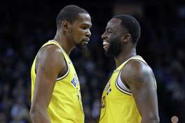 Golden State Warriors' Kevin Durant reacts to a Draymond Green technical foul in 4th quarter of Warriors' 125-123 win over Sacramento Kings in NBA game at Oracle Arena in Oakland, Calif., on Thursday, February 21, 2019.