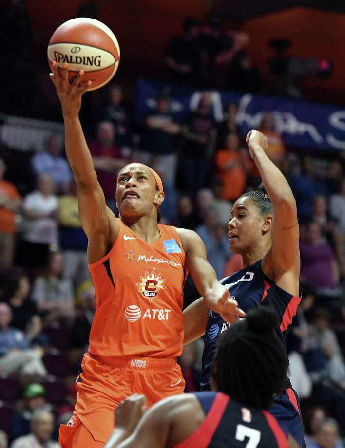 Connecticut Sun guard Jasmine Thomas scores around Mystics guard Natasha Cloud on Tuesday. Photo: Sean D. Elliot / The Day Via AP / 2019 The Day Publishing Company