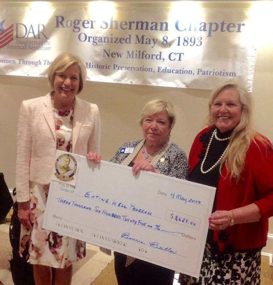The Roger Sherman Chapter, National Society Daughters of the American Revolution recently donated $3,625 to the New Milford Hospital Eating Well, Plow to Plate Healthy Meals Program for cancer patients at the hospital. Above, Cindy Tyler, breast health navigator at New Milford Hospital, left, receives the check from Roger Sherman Chapter, NSDAR Regent Bonnie Butler, middle, and Jennie May Rehnberg of the Roger Sherman Chapter, NSDAR. Photo: Courtesy Of Roger Sherman Chapter, NSDAR / The News-Times Contributed