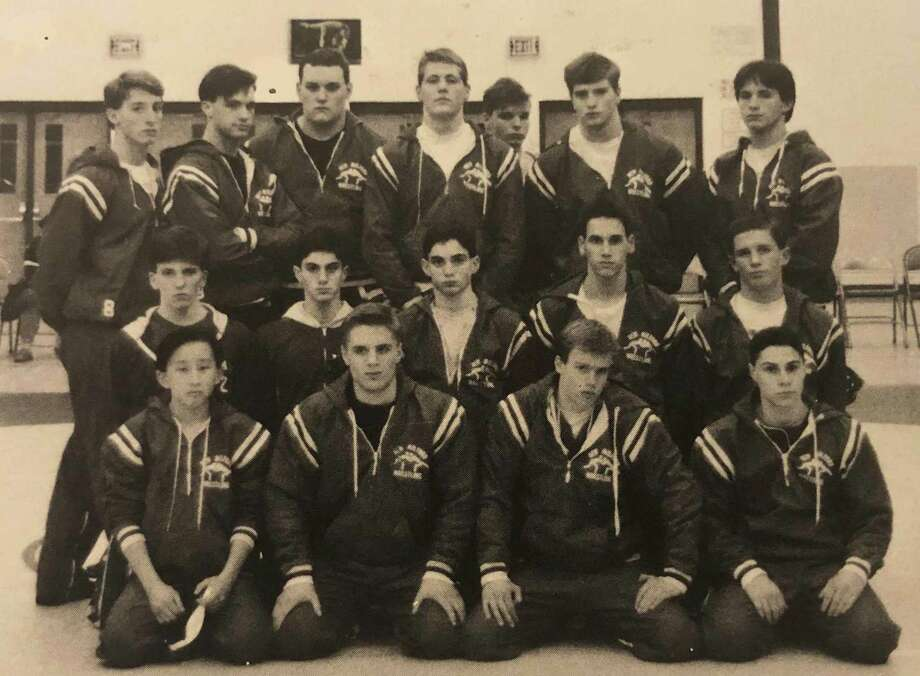 "Let's throw it back to New Milford High School sports in the early 1990s. Above is the varsity wrestling team for the 1991-92 school year. Shown above are, from left to right, in front, David Lee, Jeremy Boczulak, Scott Wargo and Dave Mazzotta; second row, Erich Doubek, Jim Steinberg, Steve Steinberg, Chuck Eisenberg and Brian Richards; and in back, Dean Mantion, Steve Ashley, Joe Gaboury, Dwayne MacInnis, Dave Pearsall, Bob Davis and Tomas Browne. If you have a ""Way Back When"" photograph you'd like to share, contact Deborah Rose at drose@newstimes.com or 860-355-7324. Photo: Courtesy Of NMHS 1992 Yearbook / The News-Times Contributed"