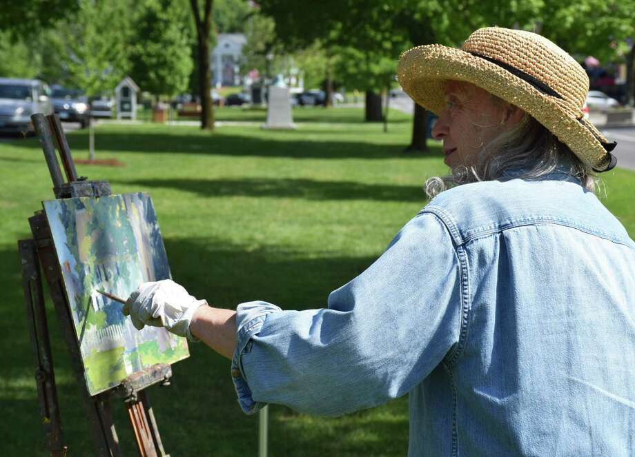 "This past weekend afforded residents of the Greater New Milford area an opportunity to get outside and enjoy the weather. Many took advantage of the early summer sun and warm temperature to participate in leisurely activities, such as the New England Watercolor Society's ""Brushes with Nature"" en plein air painting sessions. Painters visited four locations — Harrybrooke Park and The Pratt Nature Center Saturday and Hunt Hill Farm and the Village Green Sunday — to further explore their artistic skills. After, many artists gathered at Gallery 25 and Creative Arts Center on Railroad Street Sunday. Above, noted local artist Susan Grisell paints the house next to the First Congregational Church on Main Street. The house was the former home of the late Charlie Barlow. Photo: Deborah Rose / Hearst Connecticut Media / The News-Times  / Spectrum"
