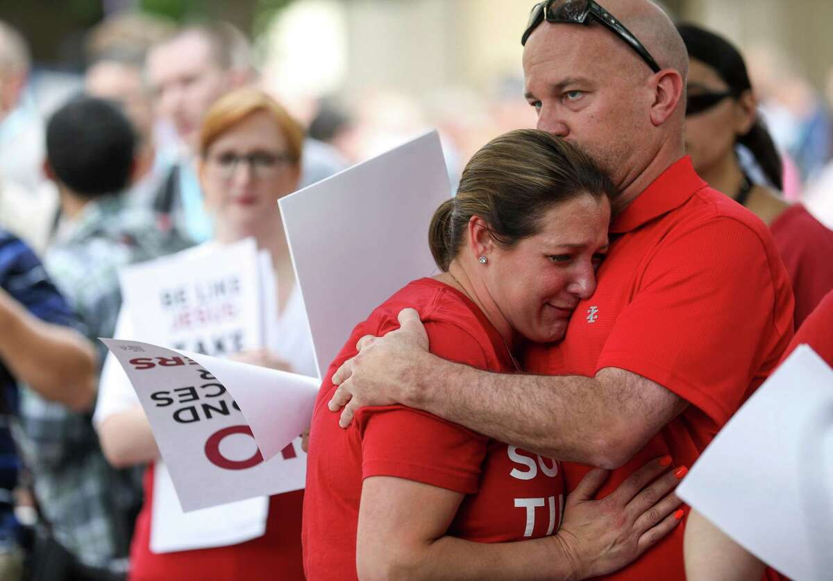 """Jules Woodson, a sexual assault survivor, cries as she hugs her boyfriend Ben Smith, after telling her story during a rally on the first day of the Southern Baptist Convention's annual meeting on Tuesday, June 11, 2019, in Birmingham. """"I was certainly impressed with how much influence she has,"""" Smith said. """"I wanted to see how much I could support her."""""""