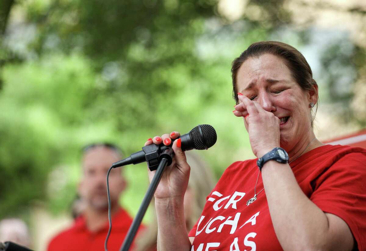 Jules Woodson, a sexual assault survivor, cries as she tells her story during a rally on the first day of the Southern Baptist Convention's annual meeting on Tuesday, June 11, 2019, in Birmingham.