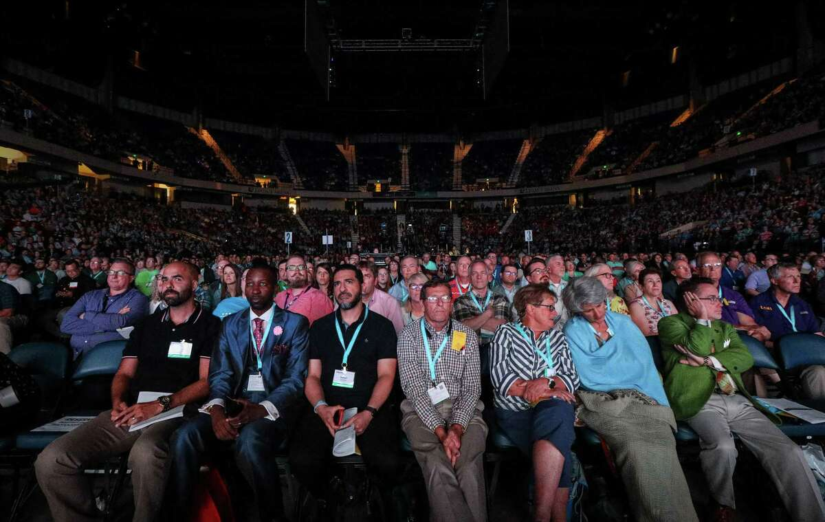 People listen to a presentation by the International Mission Board on the first day of the Southern Baptist Convention's annual meeting on Tuesday, June 11, 2019, in Birmingham.