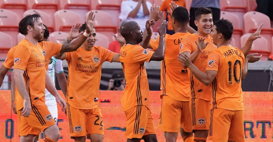 Houston Dynamo players celebrate a goal by Tomas Martinez (10) against Austin Bold during the first half of the Lamar Hunt U.S. Open Cup at BBVA Stadium Tuesday, June 11, 2019, in Houston. Photo: Melissa Phillip/Staff Photographer / © 2019 Houston Chronicle
