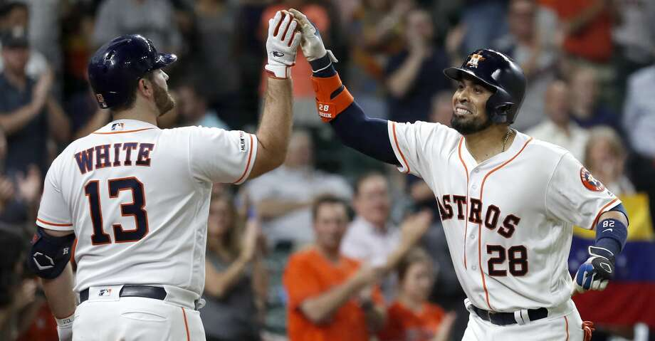 Houston Astros Robinson Chirinos (28) celebrates with Tyler White (13) after hitting his two-run home run during the seventh inning of an MLB baseball game at Minue Maid Park, Tuesday, June 11, 2019. Photo: Karen Warren/Staff Photographer