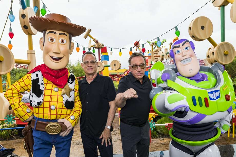 In this Handout provided by Disney Resorts, Stars from DisneyPixars Toy Story 4 Woody (in costume), Tom Hanks (2nd-L), Tim Allen (2nd-R) and Buzz Lightyear (in costume) appear with characters from the film inside Toy Story Land at Disneys Hollywood Studios at Walt Disney World Resort on June 8, 2019 in Lake Buena Vista, Florida. Hanks and Allen were interviewed by BlogXilla on their knowledge of black culture and Hanks relied on his upbringing in Oakland to successfully answer questions he was asked. Photo: Handout/Disney Resorts Via Getty Images