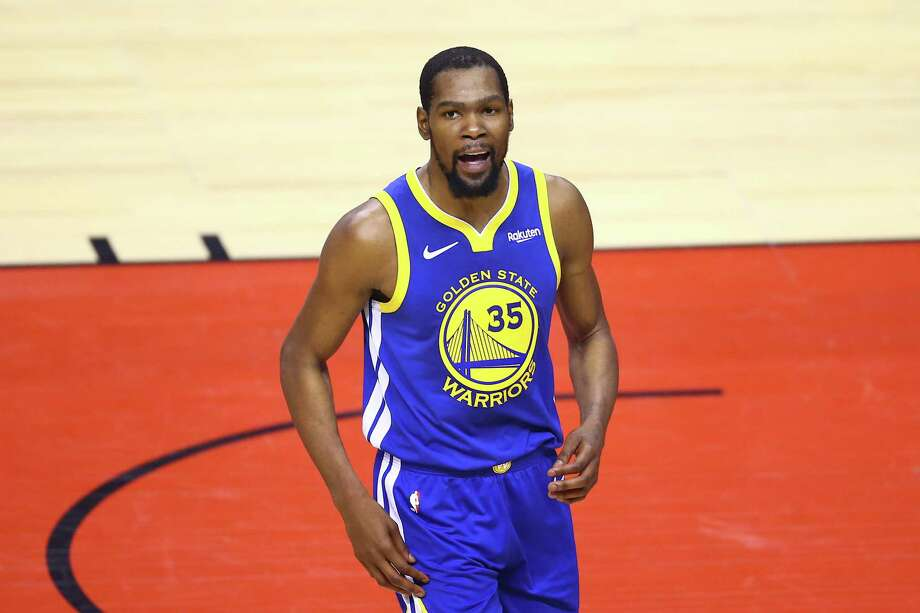TORONTO, ONTARIO - JUNE 10:  Kevin Durant #35 of the Golden State Warriors reacts against the Toronto Raptors in the first half during Game Five of the 2019 NBA Finals at Scotiabank Arena on June 10, 2019 in Toronto, Canada. NOTE TO USER: User expressly acknowledges and agrees that, by downloading and or using this photograph, User is consenting to the terms and conditions of the Getty Images License Agreement. (Photo by Vaughn Ridley/Getty Images) Photo: Vaughn Ridley / 2019 Getty Images