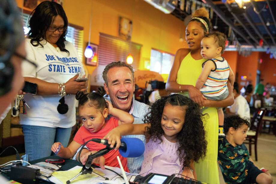 Joe Morrissey is congratulated on winning the Democratic primary against Sen. Rosalyn Dance vote by his wife, Myrna (top right) and children, Bella, Kennedy, Chase and Maverick, at a restaurant in Petersburg, Virginia. Photo: Photo By Parker Michels-Boyce For The Washington Post / For The Washington Post