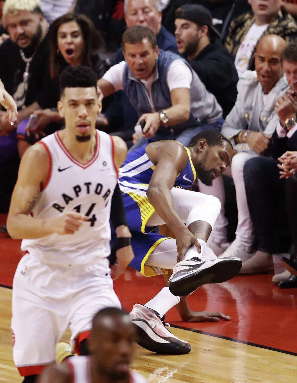 Golden State Warriors' Kevin Durant suffers an achilles injury during Warriors' 106-105 win over Toronto Raptors in NBA Finals' Game 5 at Scotiabank Arena in Toronto, Ontario, on Monday, June 10, 2019.