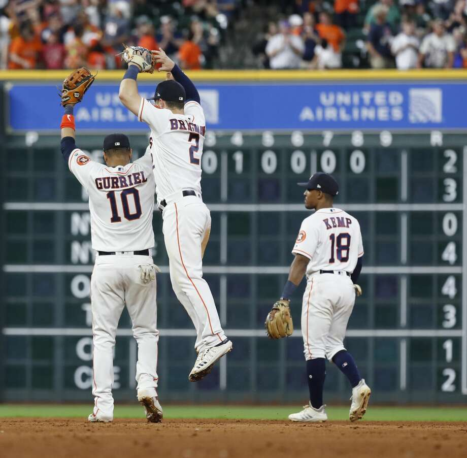 Houston Astros Alex Bregman (2) and Yuli Gurriel (10) celebrate the Astros 10-8 win over the Milwaukee Brewers during the ninth inning of an MLB baseball game at Minue Maid Park, Tuesday, June 11, 2019. Photo: Karen Warren/Staff Photographer