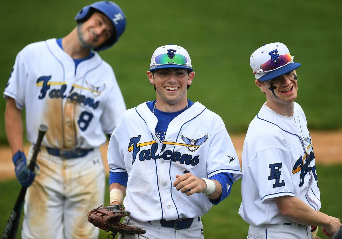 From left; Fairfield Ludlowe teammates Vince Camera, Derek Tallman, and Brian Kiremidjian smile as they head for the dugout following a fourth inning catch at the centerfield wall by Tallman in the 4th inning of their Class LL baseball playoff against rival Fairfield Warde in Fairfield, Conn. on Tuesday, May 28, 2019.