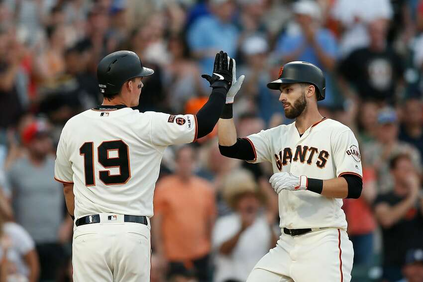 SAN FRANCISCO, CALIFORNIA - JUNE 11: Steven Duggar #6 of the San Francisco Giants celebrates with Tyler Austin #19 after hitting a two-run home run in the bottom of the fourth inning against the San Diego Padres at Oracle Park on June 11, 2019 in San Francisco, California. (Photo by Lachlan Cunningham/Getty Images)