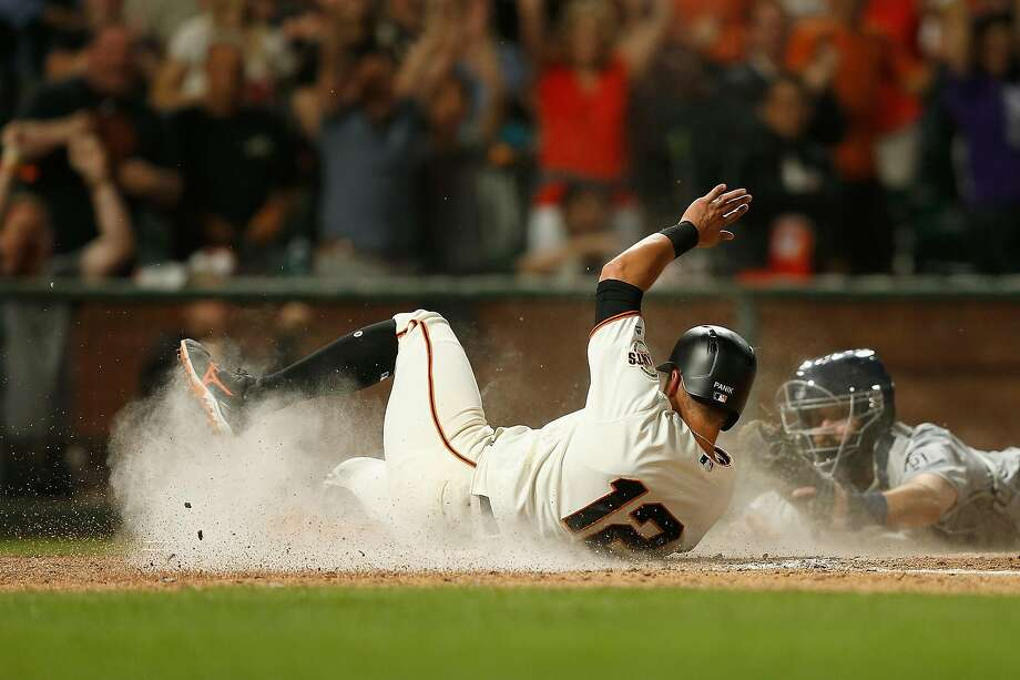 SAN FRANCISCO, CALIFORNIA - JUNE 11: Joe Panik #12 of the San Francisco Giants slides in safe at home plate against Austin Hedges #18 of the San Diego Padres to score on a double hit by teammate Evan Longoria #10 in the bottom of the seventh inning against the San Diego Padres at Oracle Park on June 11, 2019 in San Francisco, California. (Photo by Lachlan Cunningham/Getty Images) Photo: Lachlan Cunningham / Getty Images
