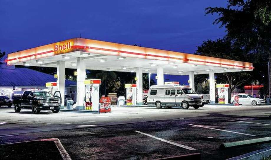 Customers fill up at a Shell station. Some owners of Illinois convenience stores that border other states are worried sharp increases in taxes on gas and tobacco products will send dollars to other states. Photo: Jeffrey Greenberg | Universal Images Group