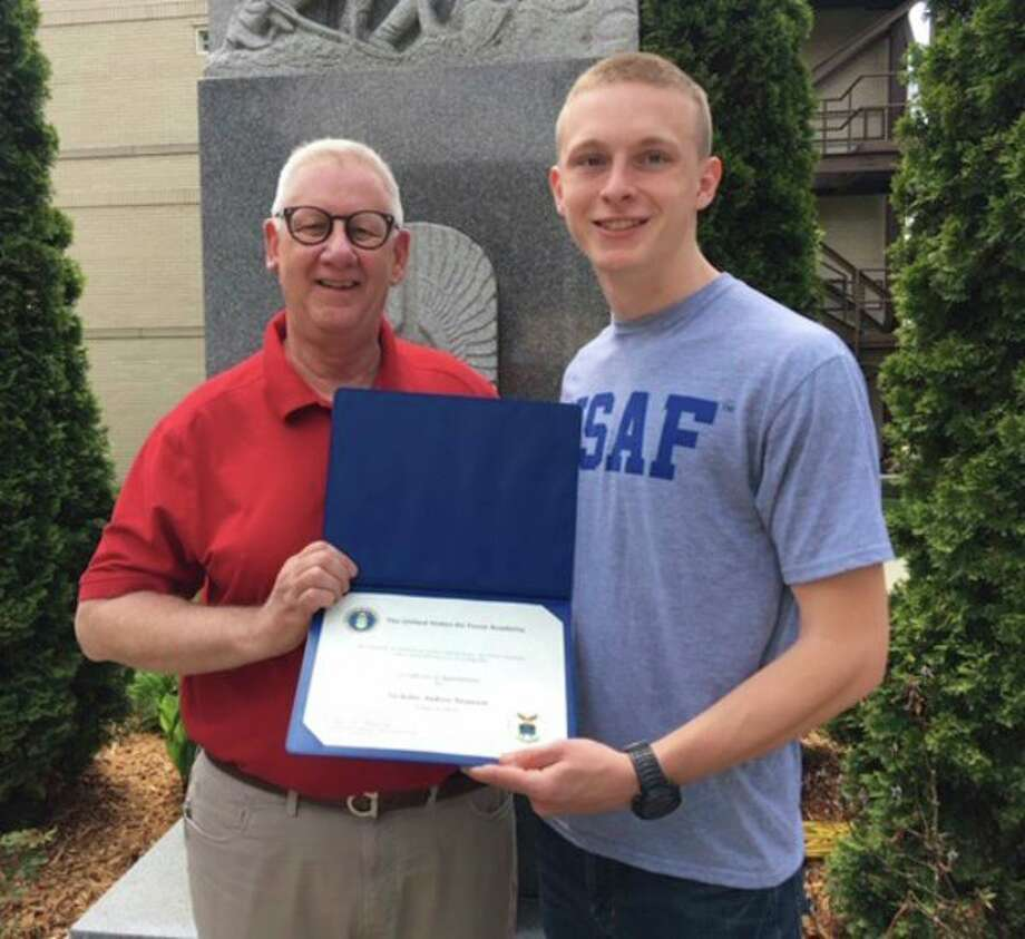 U.S. Rep. Paul Mitchell presents Nicholas Swanson, of Ubly, with his appointment to the United States Air Force Academy. (Submitted Photo)