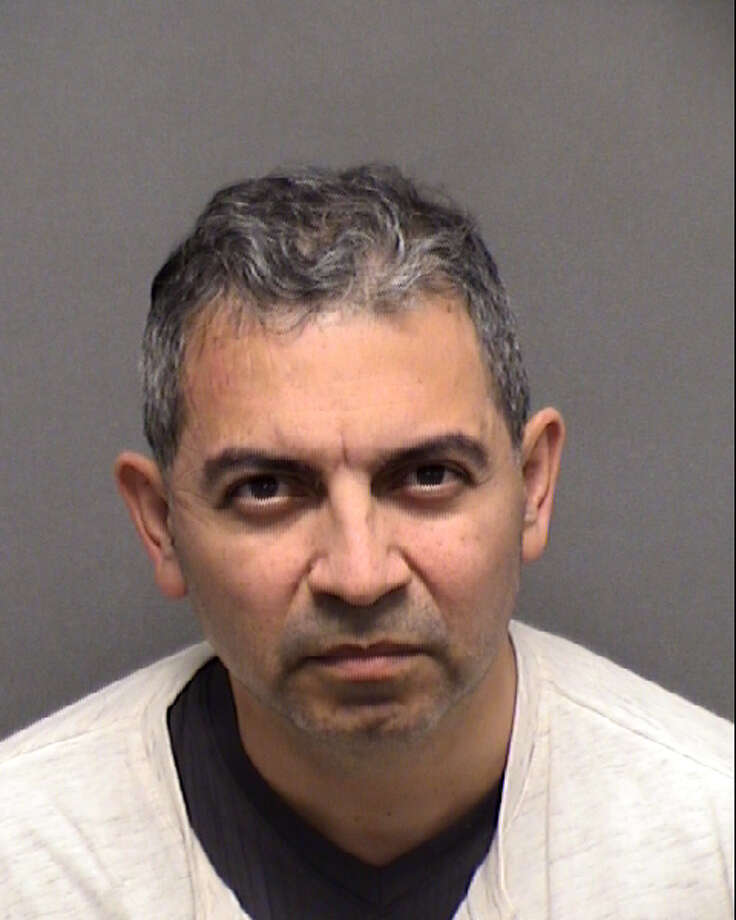 Enrique Gonzalez , 48, of Rancho Cucamonga, reportedly masturbated on a United Airlines flight on Feb. 3 while his wife  tried to help him, according to court and police records. Photo: Bexar County Sheriff's Office