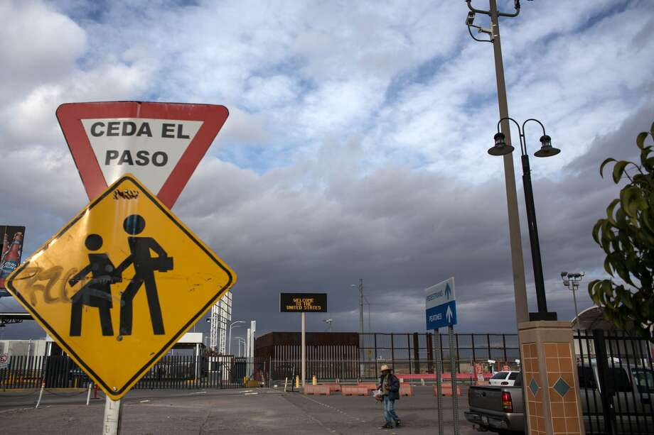 FILE - A street vendor walks near the crossing port on the US/Mexico border in Agua Prieta, Sonora on February 18, 2017, northwestern Mexico. On Monday, four men and a woman were found dead in two cars and lying on a street. Photo: GUILLERMO ARIAS/AFP/Getty Images