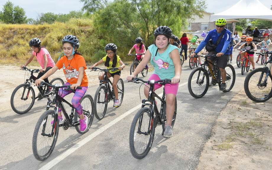 The summer program youth group from Fasken Community Center ride along Green Jay Trail, an extension to Fr. McNaboe Park, on Tuesday, Jun 11, 2019, after the trail's inauguration. Photo: Danny Zaragoza/Laredo Morning Times