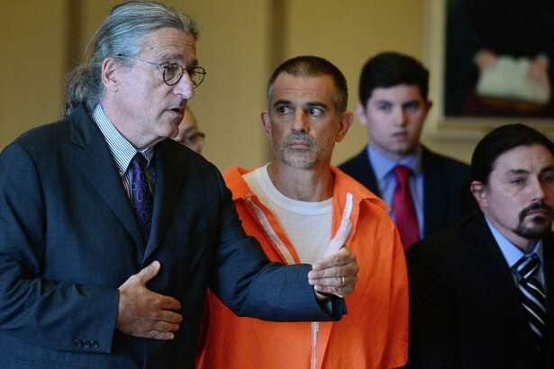 Fotis Dulos, center, listens, as his attorney Norm Pattis, left, addresses the court during a hearing at Stamford Superior Court, Tuesday, June 11, 2019 in Stamford, Conn.