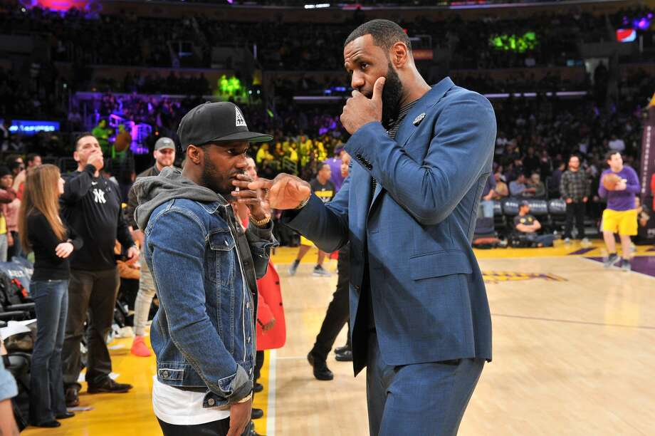 PHOTOS: Athletes wearing throwback Houston Oilers jerseys