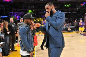 LOS ANGELES, CALIFORNIA - JANUARY 13: LeBron James talks to his agent Rich Paul during halftime of a basketball game between the Los Angeles Lakers and the Cleveland Cavaliers at Staples Center on January 13, 2019 in Los Angeles, California. (Photo by Allen Berezovsky/Getty Images)