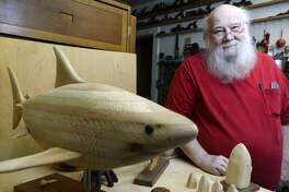 Richard Spinney poses with some of his work in his woodcarving shop at his Beaumont home. Spinney has been carving for over 40 years. Photo taken Friday 8/11/17 Ryan Pelham/The Enterprise