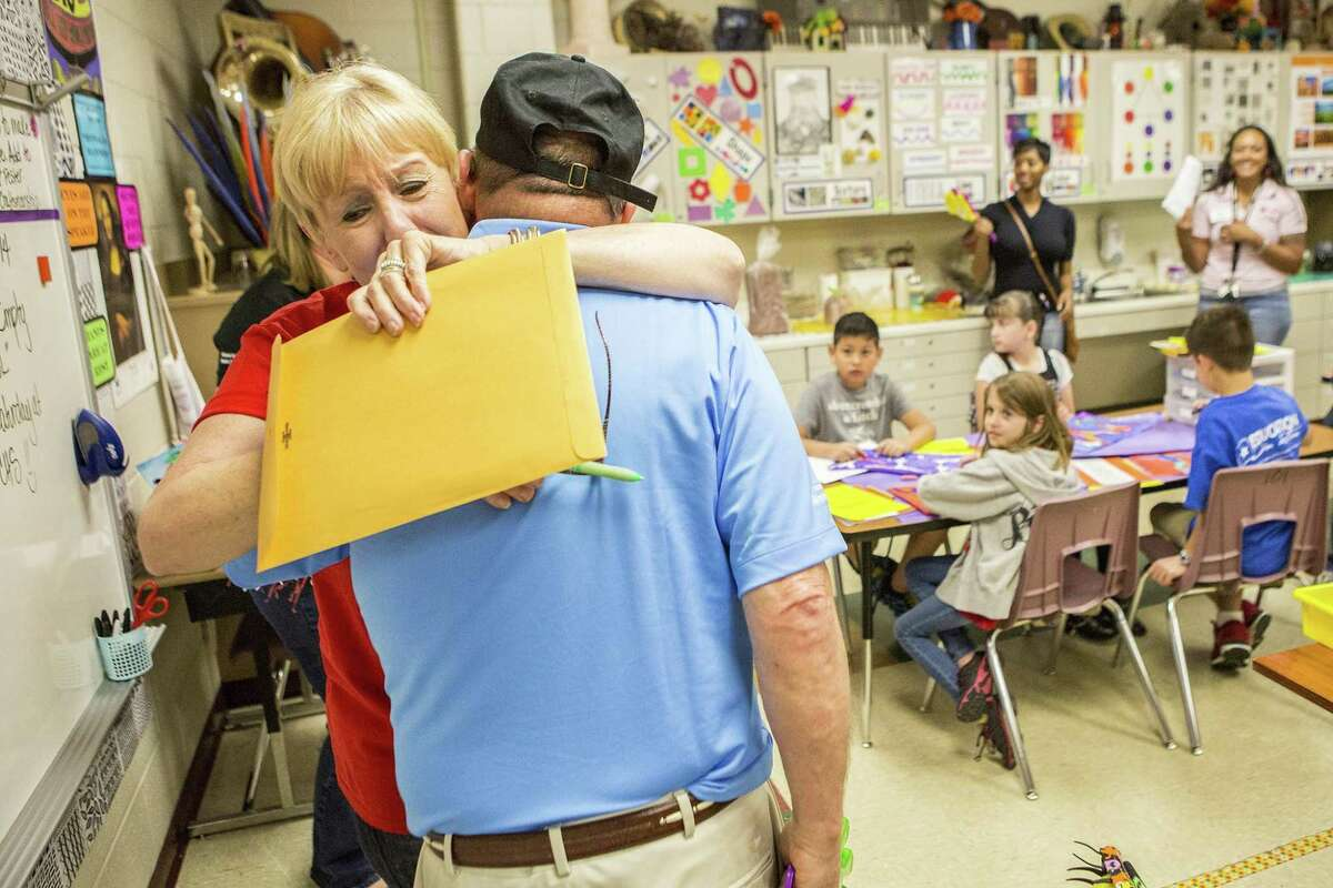Eagle Springs Elementary teacher Stacia Gower hugs a member of the Prize Posse after recieving a grant for $9,141 from the Humble ISD Education Foundation on May 9, 2014, in Atascocita. Gower recieved the grant to bring modern creative technology into the classroom allowing students to create digital portfolios of their work that they can take with them as they continue their education.