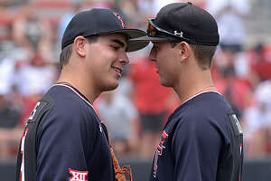 Pitcher Micah Dallas (left) and outfielder Kurt Wilson have provided some of the theatrics to get the Texas Tech Red Raiders back into the College World Series.