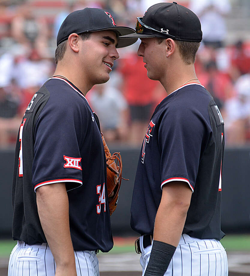 Pitcher Micah Dallas (left) and outfielder Kurt Wilson have provided some of the theatrics to get the Texas Tech Red Raiders back into the College World Series. Photo: Nathan Giese/Planview Herald