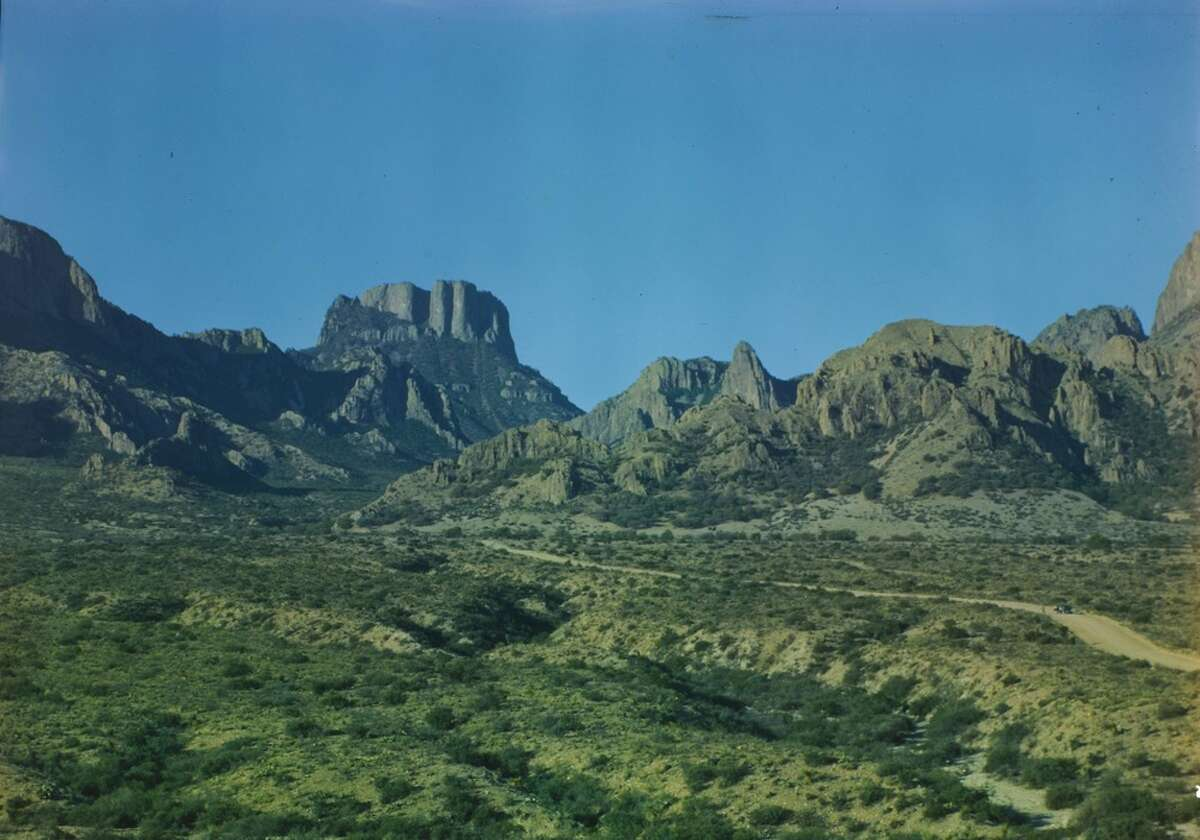 """""""Road into the Basin, Casa Grande Peak in distance."""" Natt Dodge, a park service biologist, visited the Big Bend a number of times between 1944 and 1949, and took a number of photographs while he was here. These color images provide a glimpse of the appearance and condition of Big Bend in its early years as a National Park."""