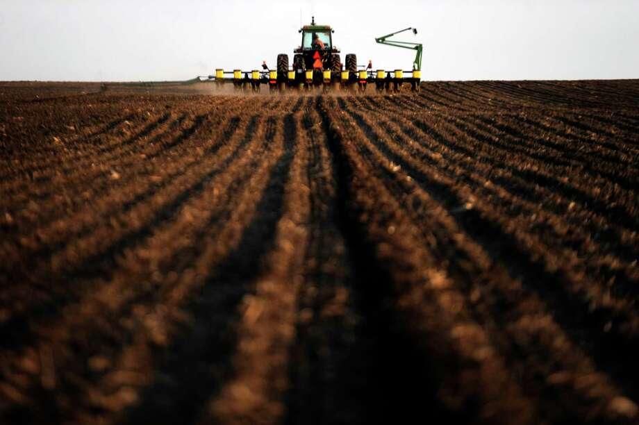 A crop farmer plants corn for the first time of the season in 2011. Photo: Washington Post Photo By Melina Mara / The Washington Post