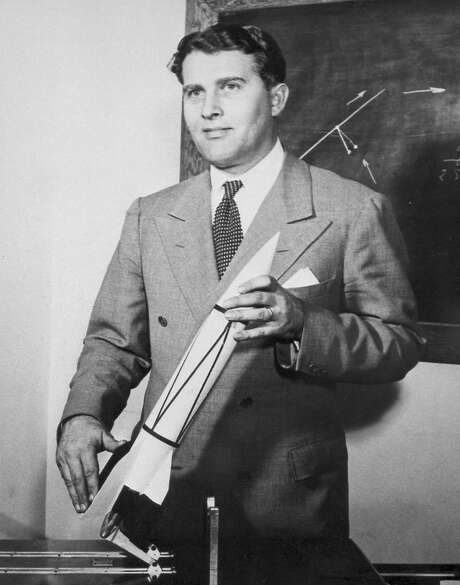 Dr. Wernher von Braun with a model of a V2 rocket. Photo: Credit: NASA