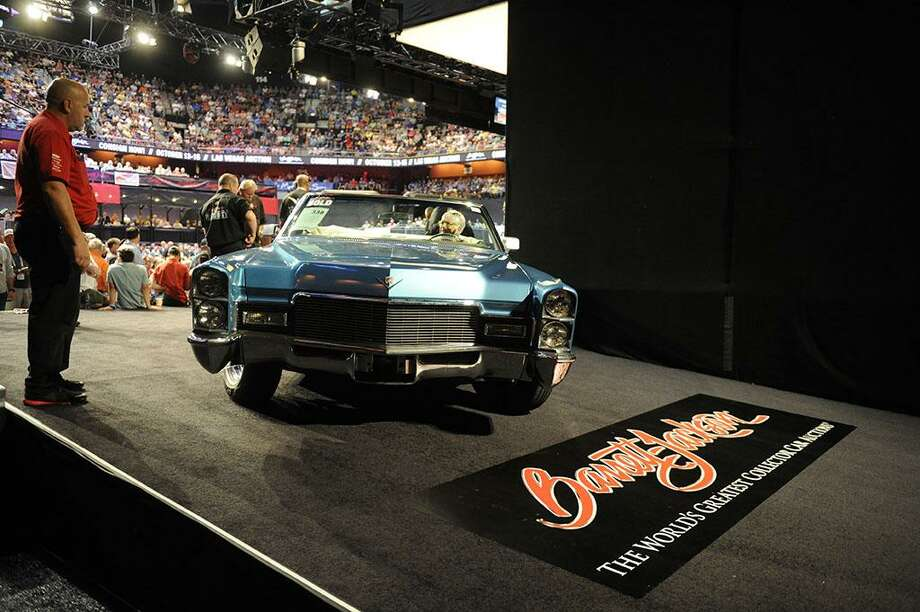 A vintage beauty is moved into position during the auction. Photo: Mohegan Sun / Contributed Photo