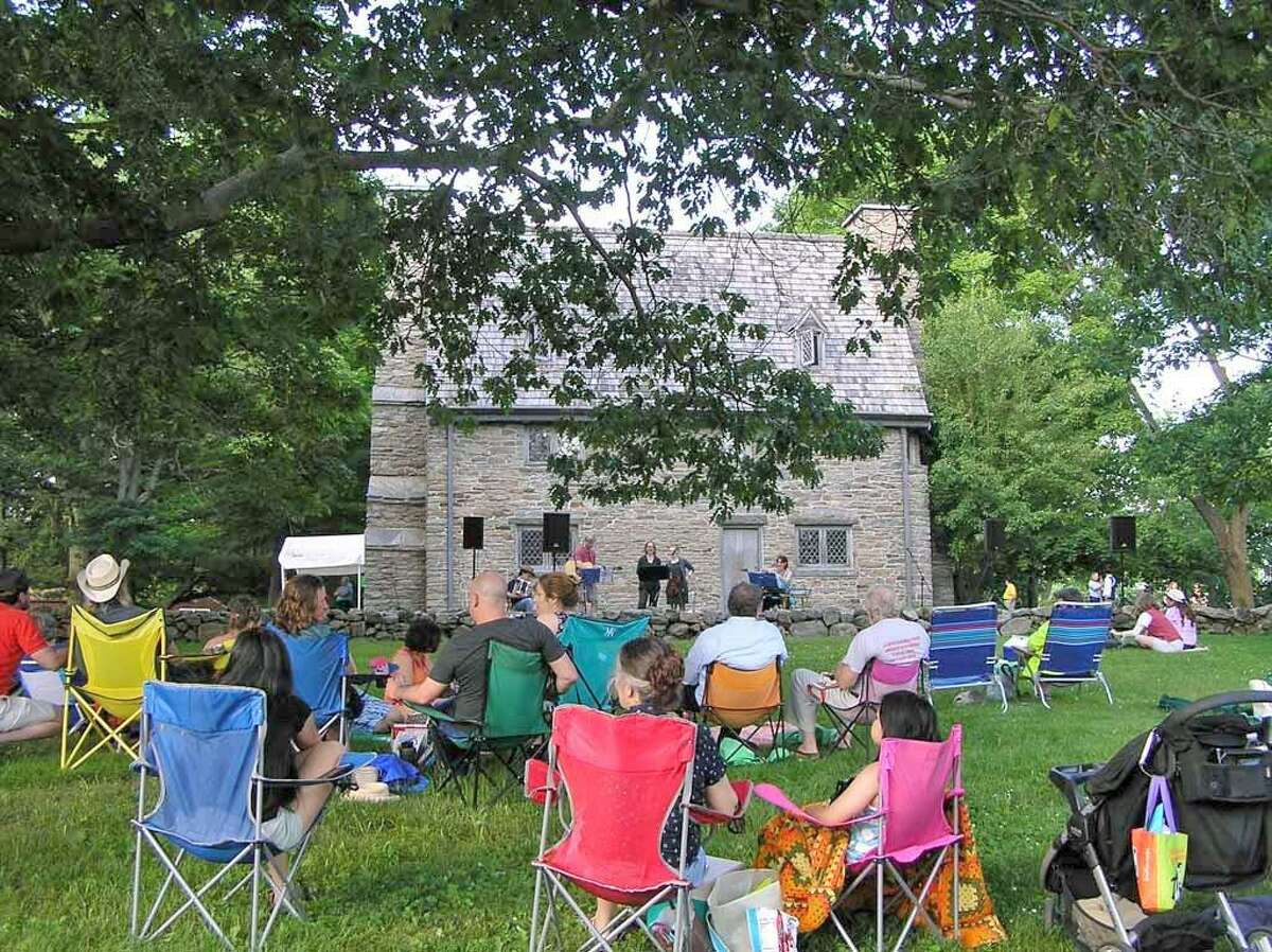 Make Music Day is celebrated June 21 from 4 to 8 p.m. at the Henry Whitfield State Museum in Guilford, shown during last year's event.