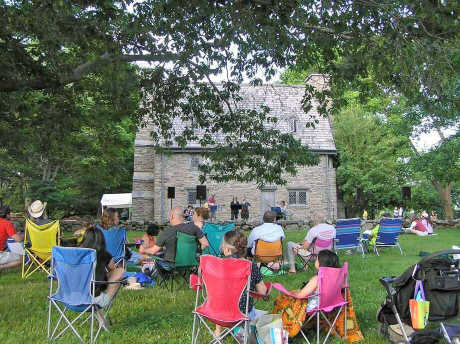 Make Music Day is celebrated June 21 from 4 to 8 p.m. at the Henry Whitfield State Museum in Guilford, shown during last year's event. Photo: Contributed /