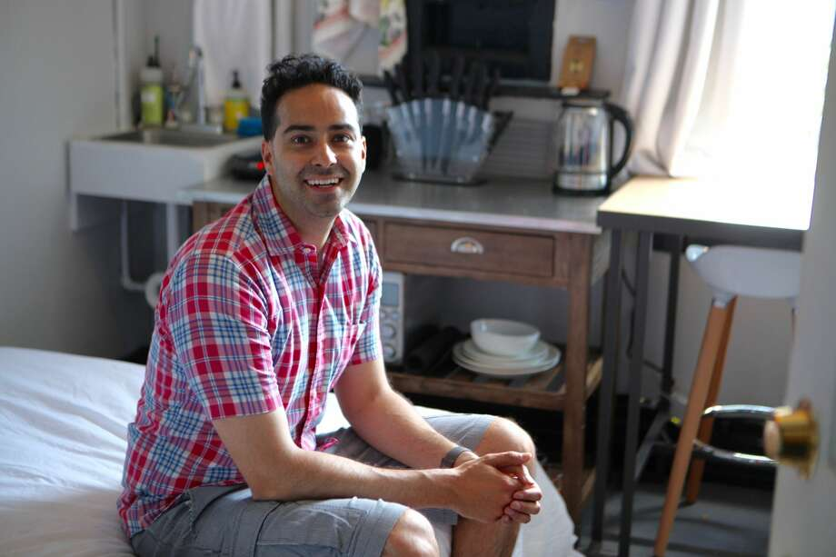 Vivek Kumar, 34, rents a 9-ft.-by-9.5-ft. unit above Zeitgeist, a popular bar on Valencia Street in San Francisco. Photo: Michelle Robertson/SFGATE