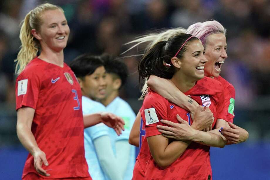 United States players Alex Morgan, middle, and Megan Rapinoe, right, celebrate a goal during the U.S. 13-0 win over Thailand. Photo: LIONEL BONAVENTURE, Contributor / AFP/Getty Images / AFP or licensors