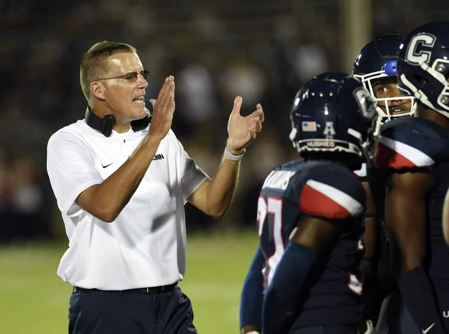 Connecticut head coach Randy Edsall encourages his team during a timeout in the 4th quarter during an NCAA college football game against Central Florida Thursday, Aug. 30, 2018, in East Hartford, Conn. UCF won, 56-17. Photo: Stephen Dunn / Associated Press / Copyright 2018 The Associated Press. All rights reserved