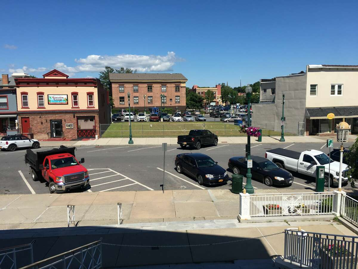 The view from the steps of Schenectady City Hall shows the fenced in lots were two apartment buildings that burned down in four years ago once stood. The owner and property manager of 104 Jay St. have agreed to pay $1 million to settle a lawsuit filed by the families of those who died and those who were injured in the in the March 6, 2015 fire that consumed two apartment buildings.