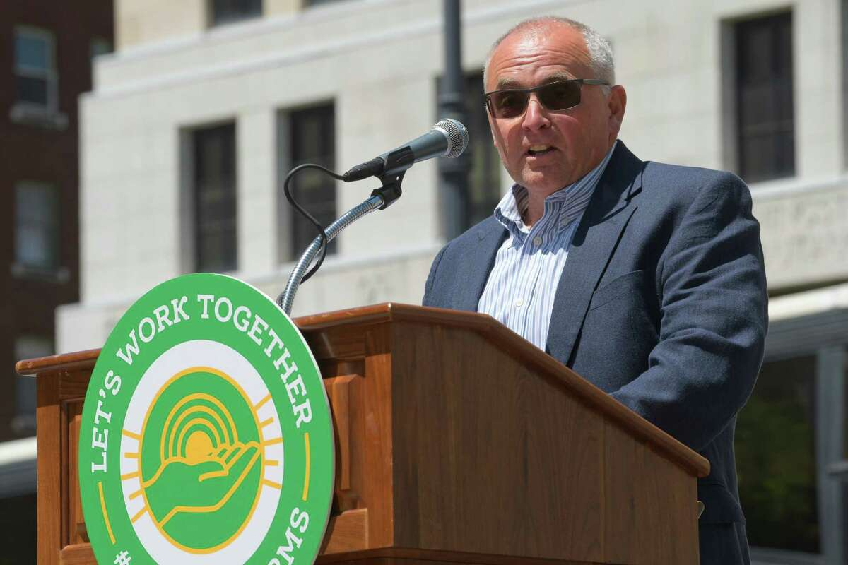 David Fisher, the New York Farm Bureau president, addresses those gathered for a rally by farm owners and farm workers on Wednesday, June 12, 2019, in Albany, N.Y. Owners and workers called on legislators to find common ground on proposed legislation that would impose wage and employment mandates. Those taking part in the rally said that the proposed legislation could actually cut workers hours and force farmer to raise prices, hurting sales. (Paul Buckowski/Times Union)
