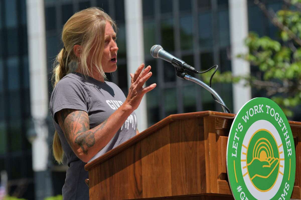Kira Kinney, owner of Evolutionary Organics in New Paltz, addresses those gathered for a rally by farm owners and farm workers on Wednesday, June 12, 2019, in Albany, N.Y. Owners and workers called on legislators to find common ground on proposed legislation that would impose wage and employment mandates. Those taking part in the rally said that the proposed legislation could actually cut workers hours and force farmer to raise prices, hurting sales. (Paul Buckowski/Times Union)