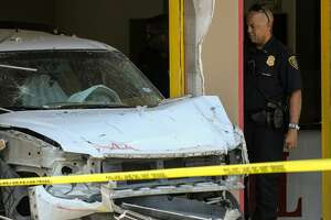Houston Police officers investigate the scene where a vehicle crashed into Medi Grill restaurant on the 5800 block of Martin Luther King Boulevard Wednesday, June 12, 2019, in Houston. One person died in the crash.