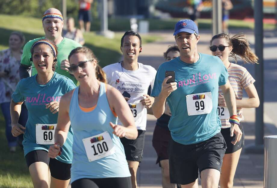 Democratic presidential candidate Beto O'Rourke, who is proposing a plan to protect LGBTQ rights, runs in the Capital City Pride Fest Fun Run 5K with wife Amy (front) in Des Moines, Iowa, on Saturday. Photo: Charlie Neibergall / Associated Press