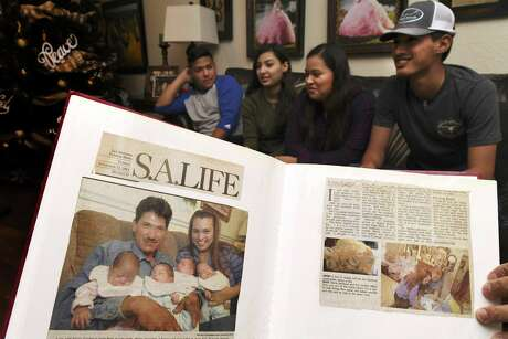 A newspaper clipping from 2001 shows the Sandoval quadruplets with their parents, Juan and Maria, months after their birth. The babies are, from left, Maria, Giovanni, Julianna and Juan.