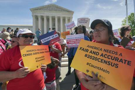 Immigration activists rally outside the Supreme Court as the justices hear arguments over the Trump administration's plan to ask about citizenship on the 2020 census. On Wednesday, the president invoked executive privilege to block Congress from obtaining documents about how the citizenship question was added.