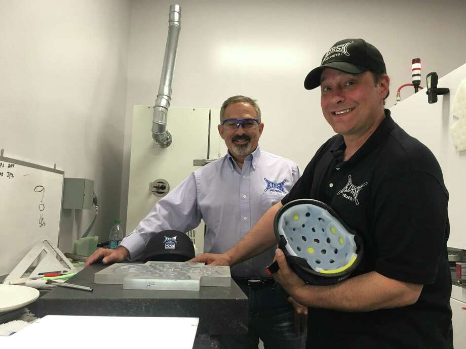 Donald DeVito and Jason Kirshon stand inside the Specialty Silicon Products manufacturing facility in Ballston Spa on June 12. The company partners with several Capital Region-based companies to produce their high-end motorcycle helmets. Photo: Diego Mendoza-Moyers / Times Union