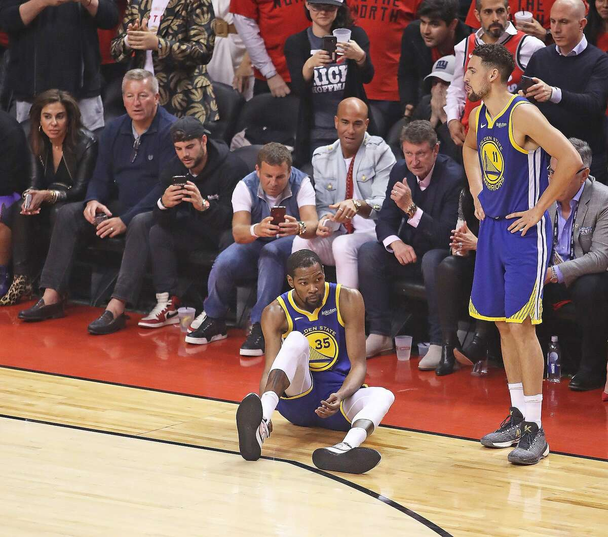 Kevin Durant #35 of the Golden State Warriors goes down with an apparent achilles injury during action against the Toronto Raptors in Game Five of the 2019 NBA Finals at Scotiabank Arena on June 10, 2019 in Toronto, Canada. (Claus Andersen/Getty Images/TNS)